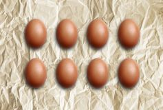 Brown eggs on a wrinkled paper. Royalty Free Stock Images