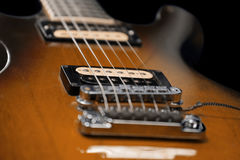 Brown electric guitar detail Stock Photography