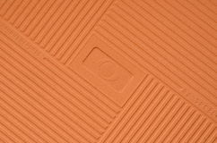 Brown embossed reverse side of small tile Stock Photos
