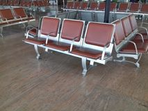 Brown empty chairs at airport Stock Photo