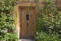Brown entrance doors to an english house Stock Photo