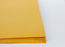 Brown envelop overlay on white background Stock Photos