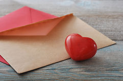 Brown envelop with stone heart Royalty Free Stock Image