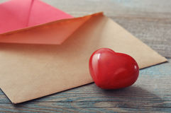 Brown envelop with stone heart Stock Image