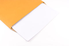 Brown envelope. And blank document isolated on white background Stock Photos