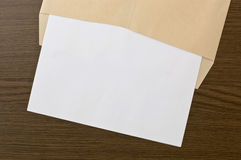 Brown envelope and blank paper Royalty Free Stock Image