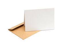 Brown envelope with a blank white card Stock Photo