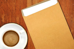 Brown Envelope document and a white coffee cup Stock Photos