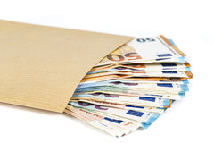 Brown envelope with full of euro banknotes on white background. Concept of corruption and bribery Royalty Free Stock Photography