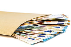 Brown envelope with full of euro banknotes on white background. Concept of corruption and bribery Stock Image