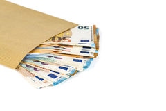 Brown envelope with full of euro banknotes on white background. Concept of corruption and bribery Stock Photo