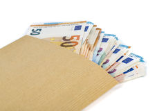 Brown envelope with full of euro banknotes on white background. Concept of corruption and bribery Stock Images