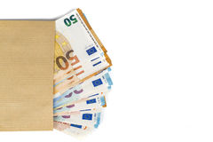 Brown envelope with full of euro banknotes on white background. Concept of corruption and bribery Royalty Free Stock Photos