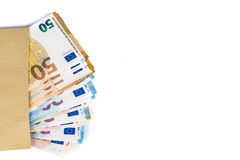Brown envelope with full of euro banknotes on white background. Concept of corruption and bribery Stock Photos