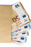 Brown envelope with full of euro banknotes on white background. Concept of corruption and bribery Stock Photography