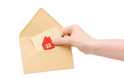 Brown envelope with house icon. In a female hands Royalty Free Stock Photography