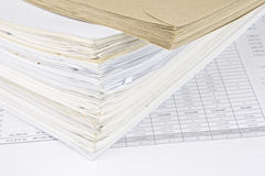 Brown envelope and overload of old paperwork Royalty Free Stock Image