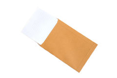 Brown envelope and paper note isolate on white background Stock Photography
