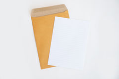 Brown envelope and paper note isolate on white background Royalty Free Stock Image
