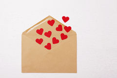 Brown envelope with red paper hearts inside Royalty Free Stock Photos