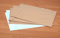 Brown envelopes on table Royalty Free Stock Photography