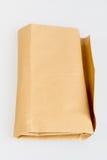 Brown envuelve en la tabla blanca Imagen de archivo