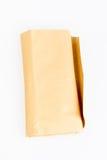 Brown envuelve en la tabla blanca Foto de archivo