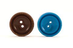 Brown et boutons bleus de vêtements Photographie stock libre de droits