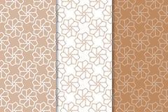 Brown et ensemble de blanc de modèles sans couture géométriques Images stock