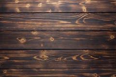 Brown et jaune ont balayé les planches en bois brûlées pour le fond Images stock