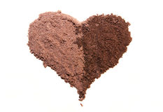 Brown eye shadows. Brown eyeshadows  heart shaped on the white background Royalty Free Stock Image