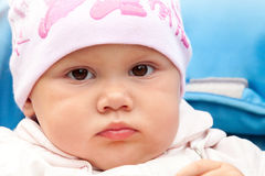 Brown eyed baby girl in pink hat Stock Photography