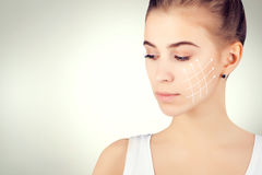 Brown eyed blond model portrait with skin surgery mark on grey Stock Images
