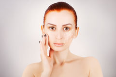 Brown eyed red haired model portrait with skin surgery mark iso Stock Image