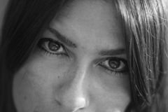 Brown eyed woman black and white close up portrait. Royalty Free Stock Photography