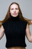 Brown-eyed woman in knitted vest Stock Images
