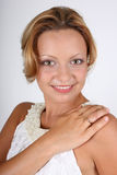 Brown-eyed woman in white with ring on her finger Stock Photography