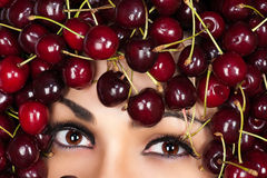 Brown eyes woman in cherry Stock Photos