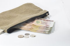 Brown fabric bag with Thai banknote and coins Stock Images
