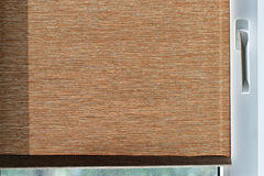 Brown fabric blinds on white plastic window Royalty Free Stock Photos