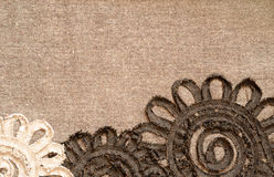 Brown fabric with flowers. Background of brown fabric with ribbon flowers Stock Photography