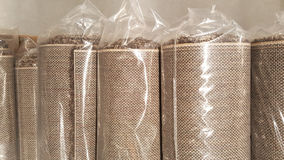 Brown fabric roll wrapped in plastic roll bag / stock of brown fabric for fashion design business Royalty Free Stock Image