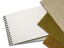 Brown Fabric sample and Blank White Page of Note Book Stock Photography