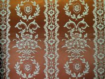 Brown fabric texture with white floral ornaments. Beautiful brown fabric with floral ornaments, can use as background stock photo