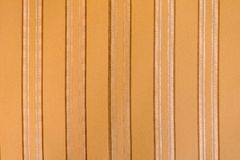 Brown fabric with vertical stripes as a background or texture royalty free stock images