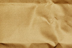 Brown fabric wrinkled texture background. Royalty Free Stock Photography
