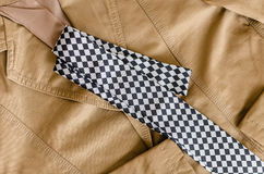 Brown fashion jacket with black and white  necktie Stock Photography