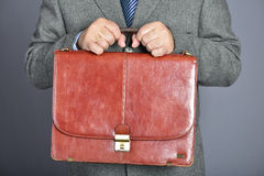 Brown fashion suitcase. Man, dressed in formal suite with elegant briefcase Royalty Free Stock Photography