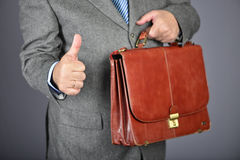 Brown fashion suitcase. Man, dressed in formal suite with elegant briefcase Royalty Free Stock Photo