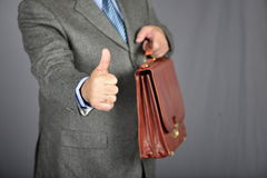 Brown fashion suitcase. Man, dressed in formal suite with elegant briefcase Royalty Free Stock Photos